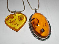 https://www.vcalc.com/attachments/e6cd5958-da27-11e2-8e97-bc764e04d25f/200px-Amber.pendants.800pix.050203.jpg